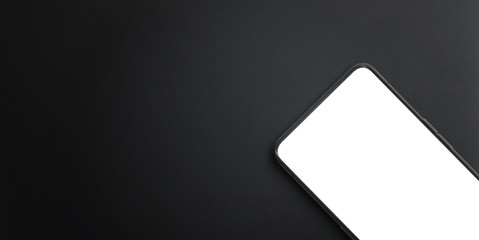Modern mobile phone close-up on black surface. Isolated screen for mockup, app presentation. Copy...