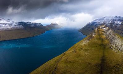 Wall Mural - Island of Kalsoy and the Klakkur mountain near Klaksvik on Faroe Islands