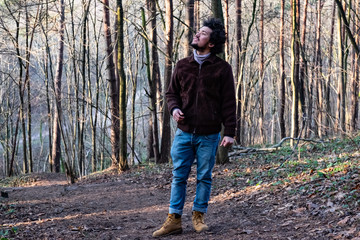 man in forest looking up
