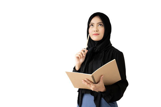 Portrait of beautiful Asian muslim student holding a book and pencile, Muslim student thinking.  Isolated on white background.