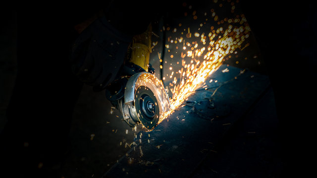 angle grinder with sparks close up