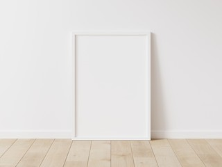 Vertical white frame mock up. Wooden frame poster on wooden floor with white wall. 3D illustrations.