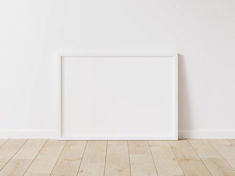 Horizontal white frame mockup. Wood frame on wood floor. 3d illustrations.