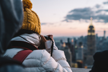 Woman taking photo of metropolis district