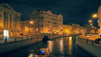 Fotobehang - Tourist boat trip at Moyka River Canal in Saint Petersburg, Russia at night. 4K UHD.