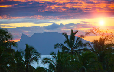Sunset over the sea and mountains,  Tahiti...