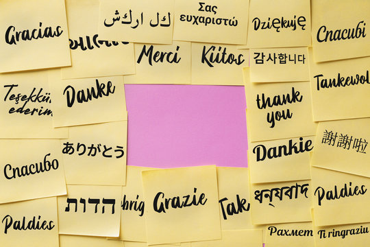 """The word """"thank you"""" on paper cards written in different languages of the world and in the center there is a place for text"""