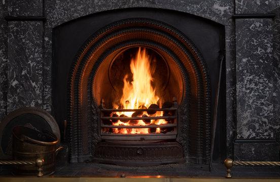 Blazing coal fire burning in victorian fireplace