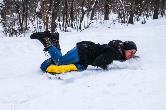 Guy riding with slides, falls with tubing. Getting injured.