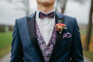 groom wearing a bow tie