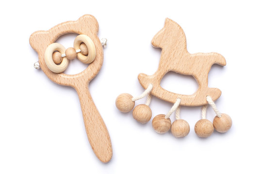 Baby wooden rattles and toys on white backgroun isolated
