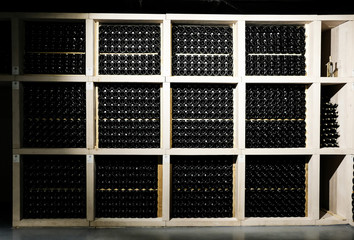 Wine bottles in the cellar. Glass wine bottles. The storage of wine. Wall mural