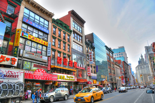 NEW YORK, UNITED STATES - FEB 6 Colorful image of a typical buildings in Chinatown's main street, New York. Chinatown has an estimated population of 100,000 people. NYC, USA, Feb 6, 2016