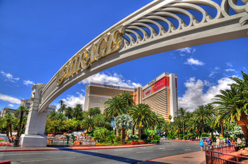 LAS VEGAS, NEVADA - MAY 16 : Colorful HDR image of The Mirage Hotel with its entrance gate in Las Vegas on May 16 2016. Was opened in 1989, and has 2.884 rooms and a casino with 100,000 square feet