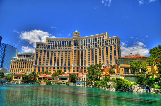 LAS VEGAS, NEVADA - MAY 16 : Colorful HDR image of Bellagio hotel and the dancing fountains in Las Vegas on May 16 2016. Bellagio is a luxury hotel and casino located on the Las Vegas Strip.