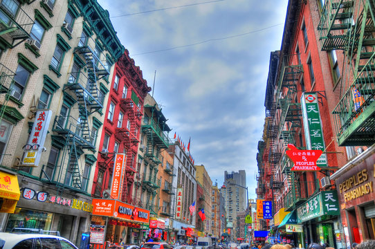NEW YORK, UNITED STATES - FEB 6 Colorful image of a typical street in Chinatown, New York. Chinatown has an estimated population of 100,000 people. NYC, USA, Feb 6, 2016