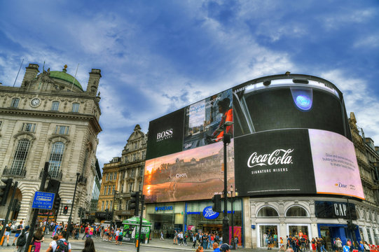 LONDON, UNITED KINGDOM, JUNE 4: colorful dramatic HDR image of the famous Piccadilly Circus in the center of London on cloudy sky. London, UK, June 4, 2019