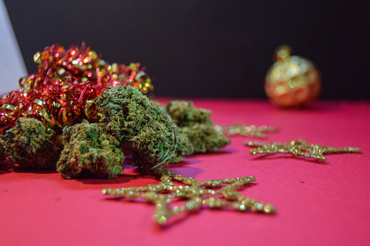 dried cannabis flowers with christmas decorations to celebrate the new year