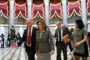 U.S. House Speaker Nancy Pelosi (D-CA) walks with House Ways and Means Committee Chairman Richard Neal (D-MA) on Capitol Hill in Washington