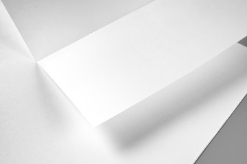Blank Folded Sheet of Paper, Flyer, or Letterhead over Stack of Paper