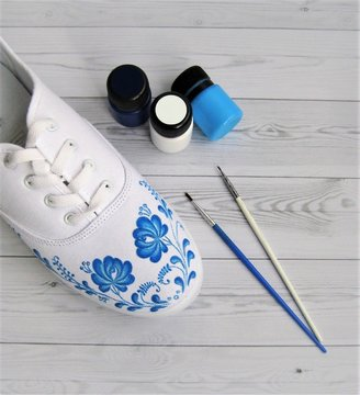 Create a fashionable design painting white sneakers