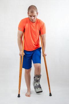 athlete with broken leg in orthopedic boot