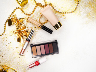 Make up for new year holiday party, makeup set. Festive new-year flat lay.