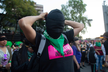 Women participate in a demonstration against gender violence, in Mexico City,