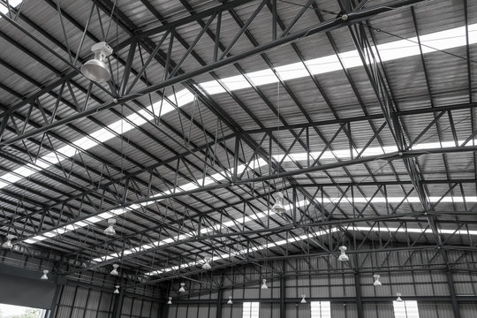 Warehouse metal roofing, Large steel roof structure, bottom view with skylight translucent roof.