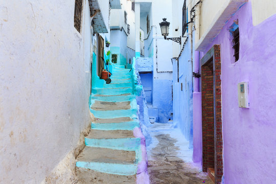 View of the colorful old walls of Tetouan Medina quarter in Northern Morocco. A medina is typically walled, with many narrow and maze-like streets and often contain historical houses, palaces, places.