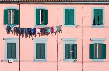 Clothes on the line along windows. Camogli, Italy