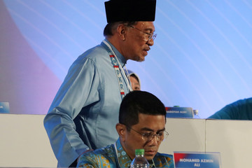 President of the PeopleÕs Justice Party Anwar Ibrahim walks pass deputy president Azmin Ali during their general assembly in Melaka