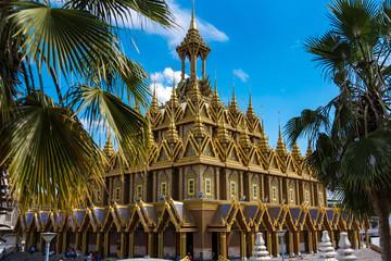 Uthai Thani, Thailand - November, 30, 2019 : Golden pagoda against blue sky at Wat Tha Sung in Uthai Thani, Thailand.