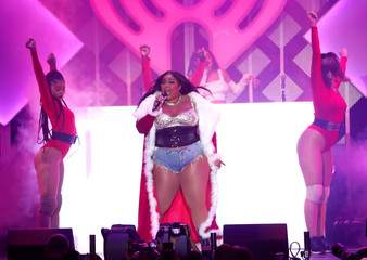 Lizzo performs during iHeartRadio Jingle Ball concert at The Forum in Inglewood