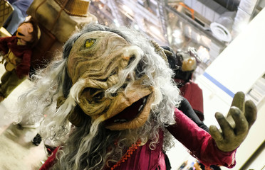 """A cosplayer dressed as Aughra from """"The Dark Crystal"""" poses during the Singapore Comic Con, in Singapore"""