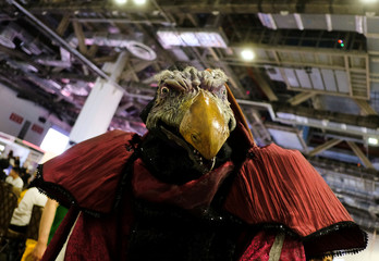 """A cosplayer dressed as Skeksil from """"The Dark Crystal"""" poses during the Singapore Comic Con, in Singapore"""