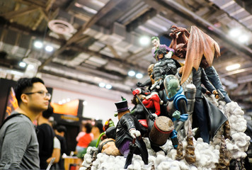 An attendee looks at figurines of DC Comics characters on display during the Singapore Comic Con, in Singapore