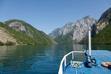 Beautiful landscape with mountains and green forests on a boat trip on the Komani lake in the dinaric alps of Albania