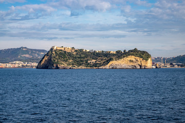 Phlegraean Islands, Naples, Campania, Italy: Isle of Nisida (volcanic islet) in the Gulf of Naples seen from the sea.
