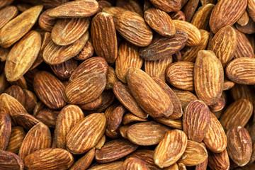 Peeled almonds background. Many almonds close up.