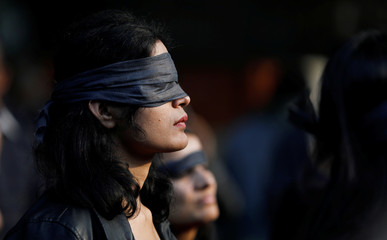 A protestor wearing a blindfold takes part in a protest in solidarity with rape victims and to oppose violence against women in India, in New Delhii