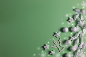 Deurstickers Lelietje van dalen Christmas banner with Xmas decoration, shiny balls, angel, tape and stars on mint background with copy space.