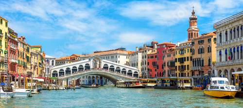 Fototapete Panoramic view of Grand Canal, Venice, Italy. Rialto Bridge in the distance. It is famous landmark of Venice.