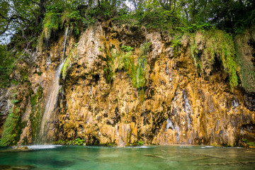 Amazing waterfalls with crystal clear water in the forest in Plitvice lakes National Park, Croatia. Nature landscape