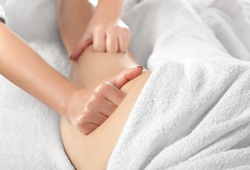 Masseur makes anti-cellulite massageon the legs, thighs, hips and buttocks in the spa. Overweight treatment, body sculpting.Cosmetology and massage concept.