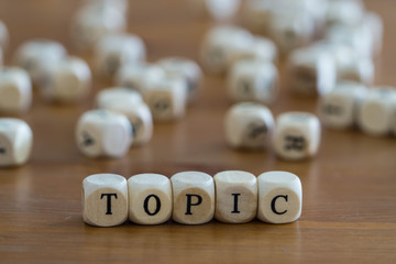 Topic written with wooden cubes
