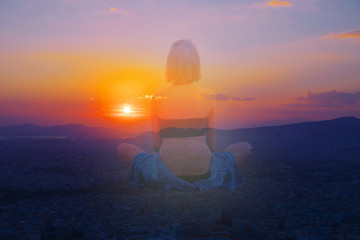 Double multiply exposure portrait of a young woman sits in a pose of lotus meditating outdoors back view, combined photograph of nature light, sunrise or sunset sky. Yoga inner mind power hope concept