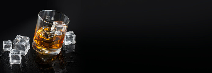 glass of whiskey with ice background