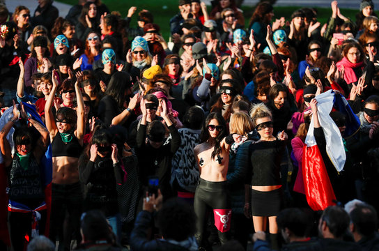 "Women rights activists wear blindfolds and sing the song ""the rapist is you"", that became famous in Chile, in front of the Palace of Justice in Rome"