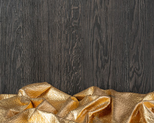 wooden dark texture with gold textil,